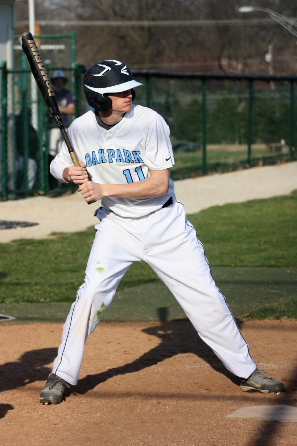 Up to bat, junior Evan Wilson prepares for the pitch.