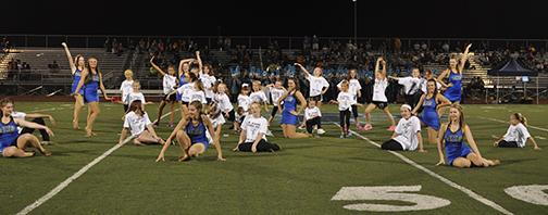 """The Pommies danced with future Pommies on Friday, Sept. 26, for the halftime show. Sophomore Pommie, Kayla Kline, said, """"The most memorable part was seeing the kids faces when we were showing them the moves. They looked really surprised."""" Kayla also says that the little kids loved preforming and learning new dance moves."""
