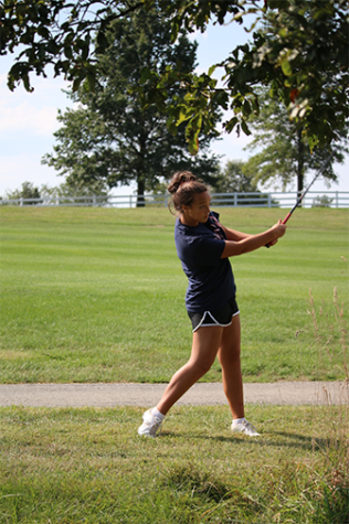 Girls golf plays in cancer tournament