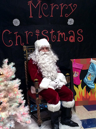 """Ho, ho, ho. Santa Claus arrived at Oak Park for FCCLA's Santa's Workshop. For the second annual Santa's Workshop, FCCLA provided cookie decorating, craft making, and pictures with Santa for kids and adults to enjoy. """"Although I wasn't able to go, I liked seeing all the posts on Facebook [advertising the event],"""" said senior Joe Haas."""