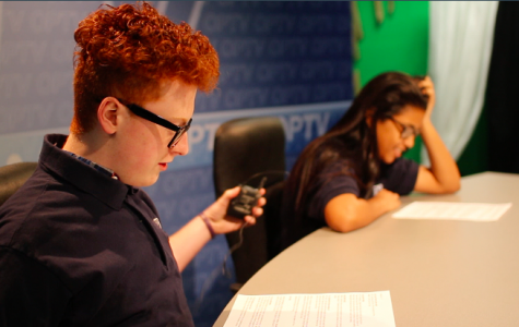 Anchors Alex Brown and Ibtisam Jeilani read through the script before going on air.
