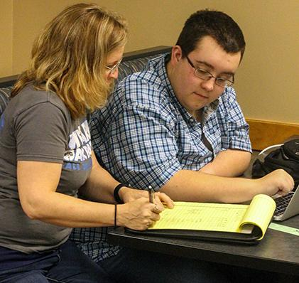 Senior Patrick Jorgenson is getting help from science teacher Nequelle DeFord during after school tutoring.