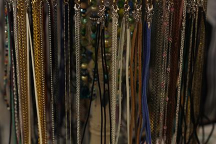 Make your own necklaces on display.