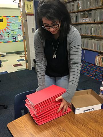 """THROWBACK THURSDAY 9th grader Elaina Shalabi tidying up folders during Freshman Community Service Day at Gashland Elementary School. Elaina use to be a student at Gashland. """"I feel so much nostalgia walking through these hallways again. Everything is just like I remember it.""""- Elaina Shalabi"""