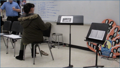 Emily Wittle volunteered to sight read with hand signing in front of the class.
