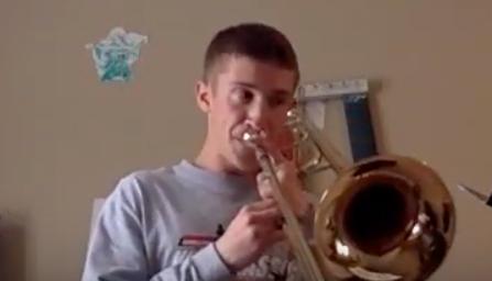 Sophomore Caleb Winkler on trombone