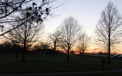 People at the park run and walk on a nice spring night at Oak Grove Park.