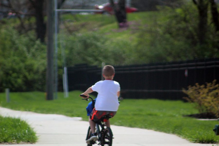 A young boy bikes on the sidewalks in a neighborhood in Gladstone. This is a great way to stay fit. The nice weather and ample sidewalks in the city offers a safe way to exercise.